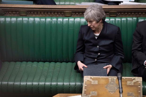 Pressure: Theresa May cuts an isolated figure in the House of Commons