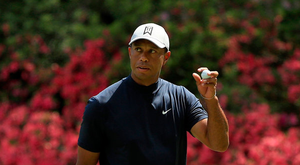 Tiger's roar: Tiger Woods acknowledges the cheers from his supporters after sinking a birdie putt during the first round of the Masters at Augusta. Photo: Mike Ehrmann/Getty Images