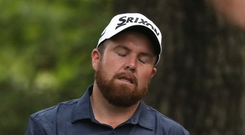 Shane Lowry reacts to a drive at the beginning of his opening round of the US Masters at Augusta. It proved to be a frustrating day and he now faces a battle to make the cut after a six-over-par round of 78. Photo: REUTERS/Jonathan Ernst