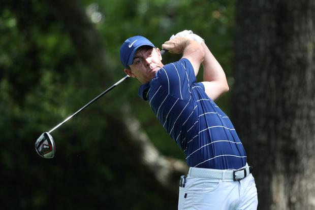 Rory McIlroy hits off the second tee during first round play