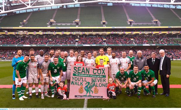 The two teams and mascots line up prior to the Sean Cox Fundraiser match between the Republic of Ireland XI and Liverpool FC Legends at the Aviva Stadium in Dublin. Photo by Sam Barnes/Sportsfile