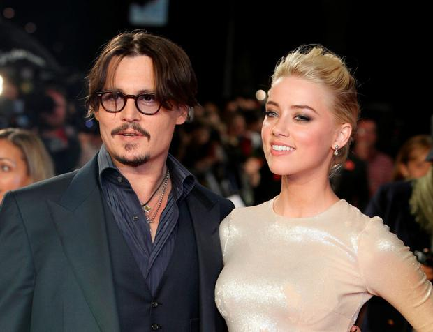 Happier times: Johnny Depp and Amber Heard at the European premiere of their film 'The Rum Diary' in London in 2011. Photo: AP/Joel Ryan, File