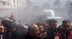 Police officers use a water cannon to disperse people protesting after parliament appointed upper house chairman Abdelkader Bensalah as interim president. Photo: Reuters/Ramzi Boudina