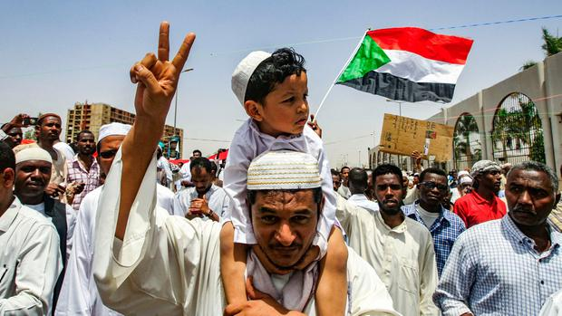 Crowd: Protesters outside army headquarters in Khartoum demand an immediate transitional civilian government. Photo: Getty Images
