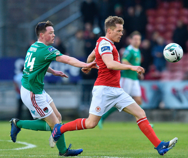 Simon Madden of St Patrick's Athletic in action against Cian Murphy of Cork City.