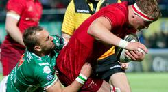 Munster's Gavin Coombes is halted in his tracks by Dewaldt Duvenage at Stadio di Monigo in Treviso. Photo by Roberto Bregani/Sportsfile