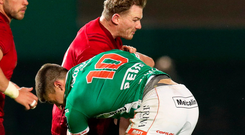 Chris Cloete of Munster Rugby is hard tackled by Tommaso Allan of Benetton Treviso. Photo by Roberto Bregani/Sportsfile