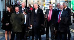 Dáil grilling: Former CEO John Delaney (centre) arrives at Leinster House, Dublin, with representatives of the Football Association of Ireland for Wednesday's committee hearing. Photo: PA