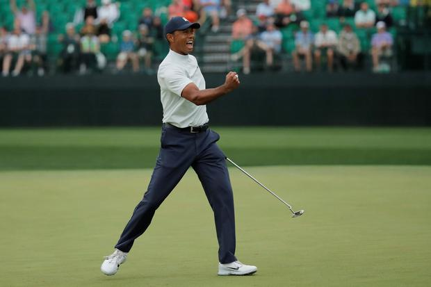Tiger Woods celebrates a birdie putt on the 15th hole during second round play at the US Masters.