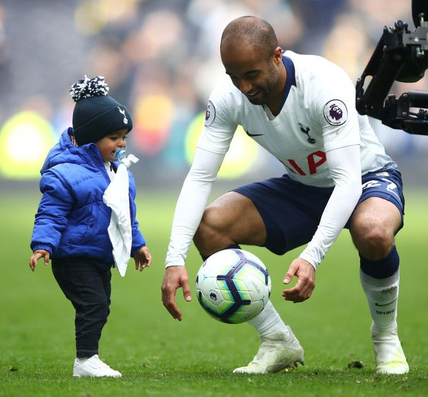 Lucas Moura of Tottenham Hotspur celebrates with his child Miguel Moura at full-time of the Premier League match between Tottenham Hotspur and Huddersfield Town at the Tottenham Hotspur Stadium (Photo by Julian Finney/Getty Images)