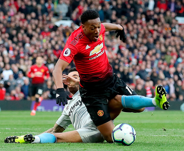 Manchester United's Anthony Martial is fouled in the penalty area by West Ham United's Ryan. Photo: Martin Rickett/PA