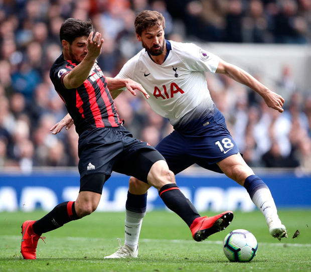 Huddersfield Town's Christopher Schindler (left) and Tottenham Hotspur's Fernando Llorente battle for the ball. Photo: John Walton/PA