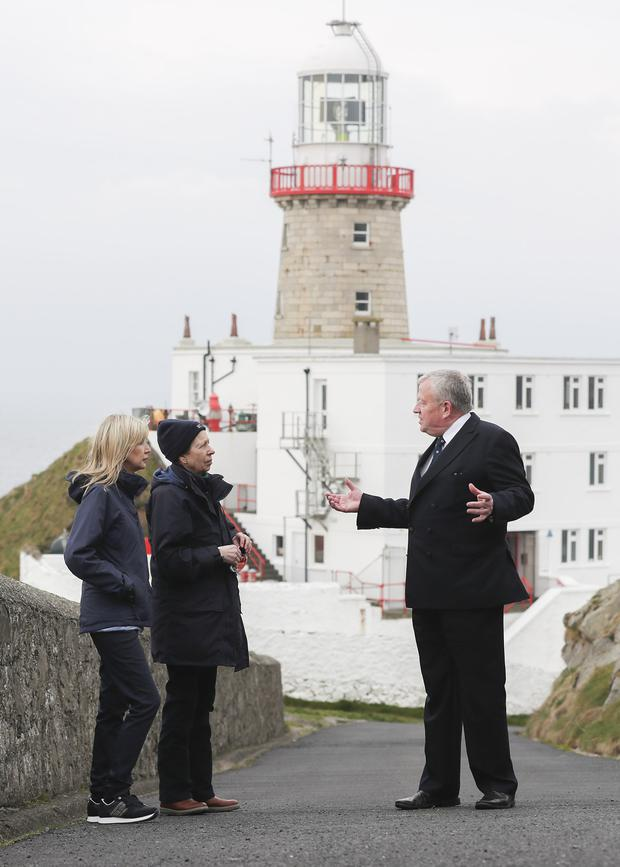 Yvonne Shields O'Connor, CEO of Irish Lights, Princess Anne and Captain Robert McCabe, director of coastal operations with Irish Lights, at the Baily Lighthouse in Howth yesterday