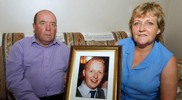 Colin and Eithne Bell with a picture of their son Kevin Credit: Belfast Telegraph