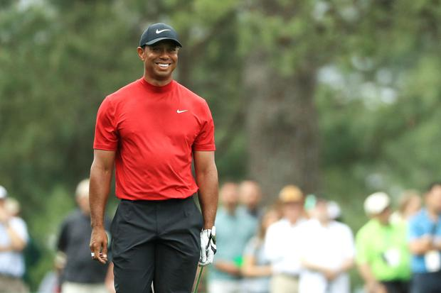 Tiger Woods of the United States smiles during the final round of the Masters at Augusta National Golf Club (Photo by Mike Ehrmann/Getty Images)