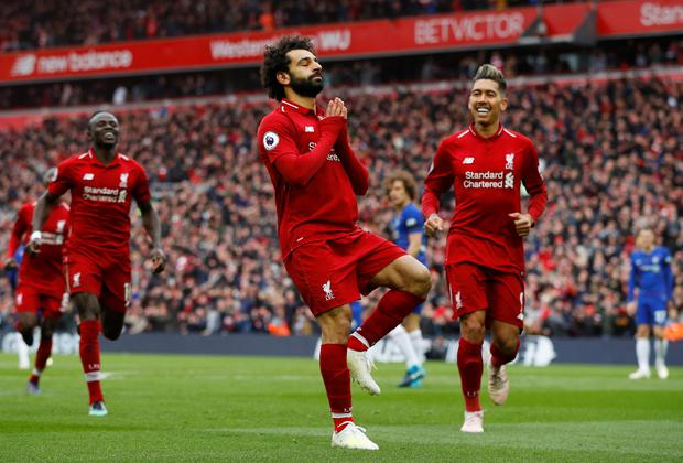 STUNNER: Mohamed Salah celebrates after beating Chelsea goalkeeper Kepa Arrizabalaga with a stunning shot in yesterday's Premier League victory over Chelsea at Anfield. Photo: REUTERS