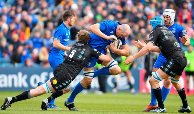 Devin Toner of Leinster is tackled by Jonny Gray of Glasgow Warriors. Photo: Ramsey Cardy/Sportsfile