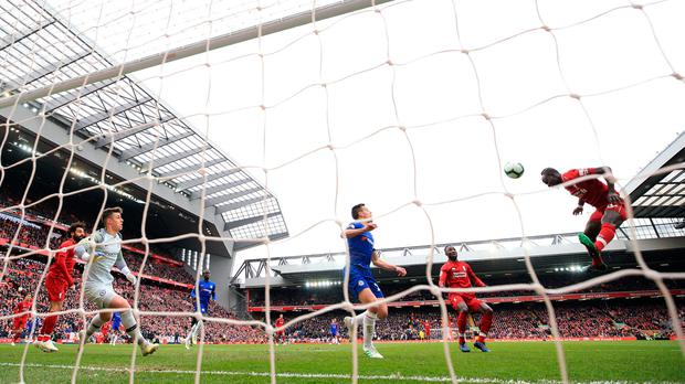 Sadio Mane heads Liverpool intop the lead at Anfield. Photo: PA