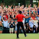Tiger Feat: Tiger Woods celebrates in front of the adoring gallery after securing victory at the US Masters, the 15th Major title of his stellar career and first in 11 years. Photo: David Cannon/Getty Images