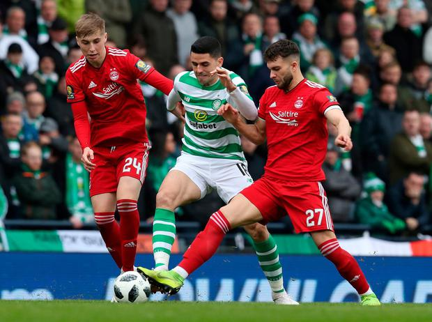 Celtic's Tomas Rogic (centre) and Aberdeen's Connor McLennan. Photo: Andrew Milligan/PA Wire