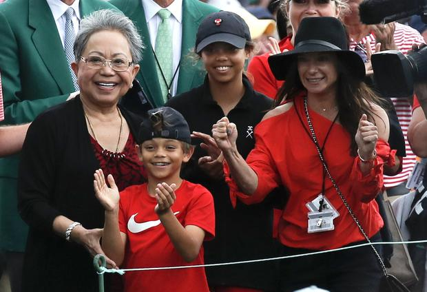Woods' family – daughter Sam, son Charlie, mother Kultida Woods (L) and girlfriend Erica Herman – smile as he approaches them after winning the Masters. Photo: REUTERS/Mike Segar