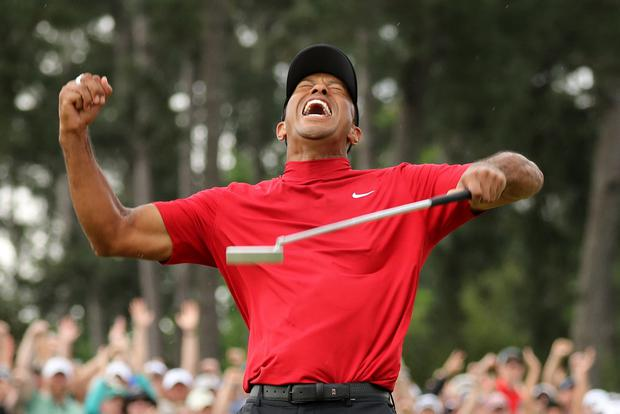 Tiger Woods of the U.S. celebrates on the 18th hole after winning the 2019 Masters. REUTERS/Lucy Nicholson