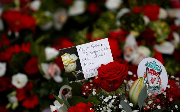 Floral tributes are left at the Hillsborough Memorial on the 30th anniversary of the Hillsborough disaster when 96 Liverpool supporters were crushed to death at the 1989 FA Cup semi-final football match between Liverpool and Nottingham Forest, outside Liverpool Football Club's Anfield Stadium, Britain, April 15, 2019. REUTERS/Phil Noble