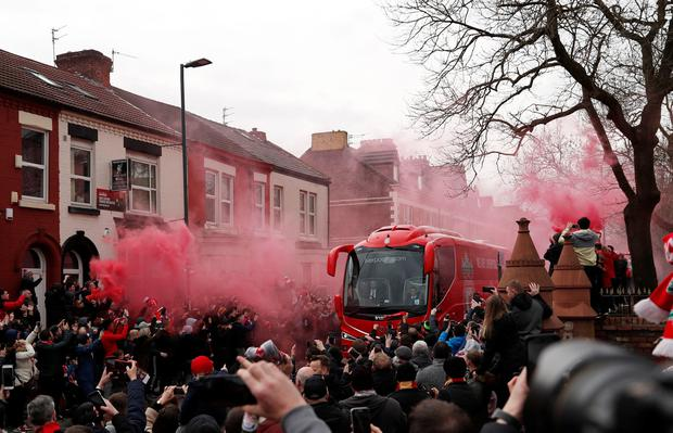 Liverpool fans welcome the teach outside Anfield