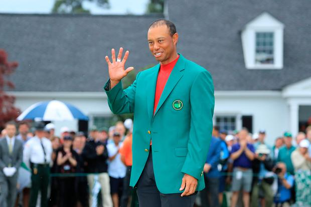 Tiger Woods smiles after being awarded the Green Jacket. Photo: Getty