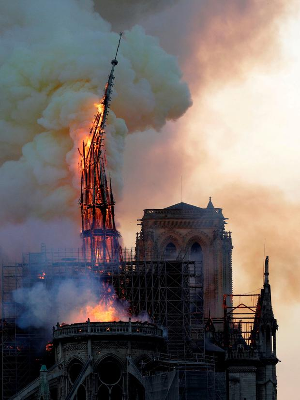 The Steeple Of The Landmark Notre Dame Cathedral Collapses As The Cathedral Is Engulfed In