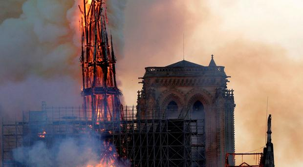 In Pictures: Fire guts Paris' Notre-Dame, but structure saved from destruction