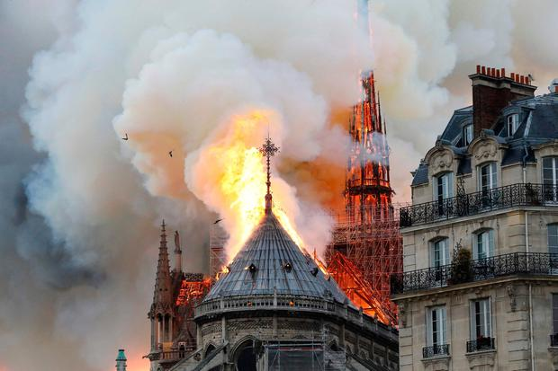 Devastated: Flames engulf the roof of Notre-Dame Cathedral in Paris. Photo: AFP/Getty Images