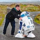 Jack Hanna from Downpatrick in County Down pushes his hand built R2D2 replica into position for the opening of the R2D2 road at Malin Head, County Donegal. Photo: Niall Carson/PA Wire