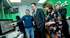 Opening day: Taoiseach Leo Varadkar in the new post office in Castleknock, with staff member Christian Ghiuzan (left), Debbie Byrne, managing director of An Post Retail, and David McRedmond, chief executive of An Post (right). Photo: Maxwells