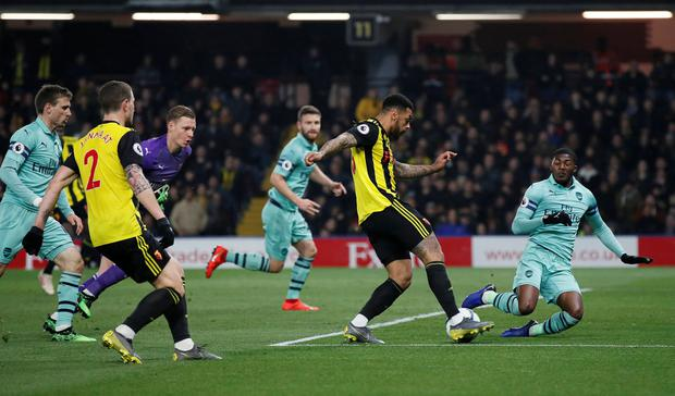 Watford's Andre Gray has a shot blocked by Arsenal's Ainsley Maitland-Niles to preserve Arsenal's clean sheet. Photo: Reuters