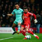 Arsenal's Pierre-Emerick Aubameyang closes down Ben Foster and scores the winning goal. Photo: Getty