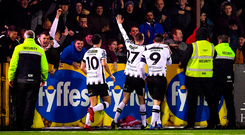Dundalk players and supporters celebrate after Patrick Hoban scores their side's only goal. Photo: Sportsfile