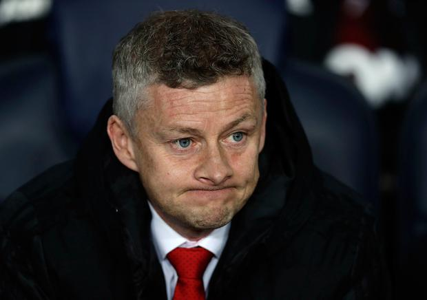 Manchester United coach Ole Gunnar Solskjaer looks out from the bench prior the Champions League quarterfinal, second leg, soccer match between FC Barcelona and Manchester United at the Camp Nou stadium in Barcelona, Spain, Tuesday, April 16, 2019. (AP Photo/Manu Fernandez)