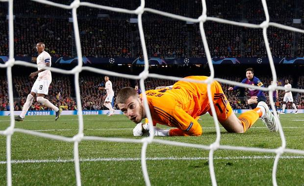 Manchester United goalkeeper David de Gea looks back into his own net forlornly after letting a shot from Barcelona's Lionel Messi slip under him. Photo: REUTERS/Sergio Perez
