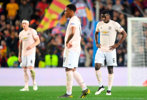 A dejected Paul Pogba reacts to Barcelona's third goal. Photo: Michael Regan/Getty Images