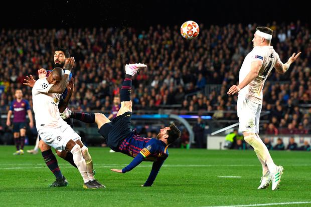 Barcelona's Lionel Messi attempts a over head kick during last night's Champions League quarter-final second leg. Photo: David Ramos/Getty Images