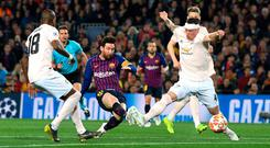 Lionel Messi shoots past Manchester United's Phil Jones to score Barcelona's second goal. Photo: David Ramos/Getty Images