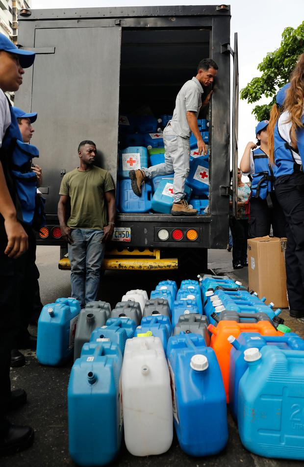 Empty water containers to be handed out with purification pills are lined up during the Red Cross' first aid shipment in Caracas, Venezuela (AP Photo/Ariana Cubillos)