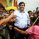 Peruvian presidential candidate Alan Garcia (C) greets supporters during a campaign rally in Catacaos, Piura, Peru May 30, 2006. REUTERS/Mariana Bazo/File Photo