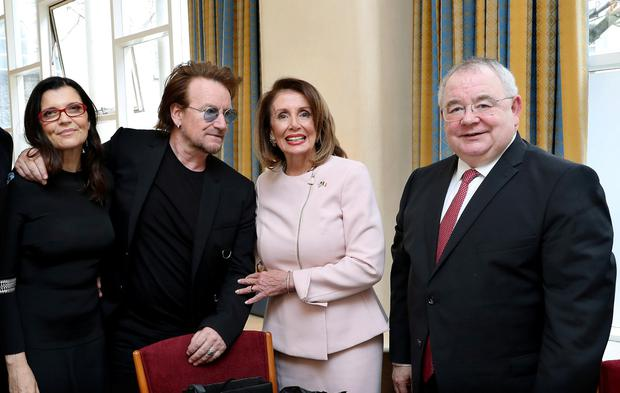 Bono and his wife Ali pose with U.S. House Speaker Nancy Pelosi and Sean O Fearghail at Leinster House in Dublin, Ireland April 17, 2019. Irish Government Pool/Maxwells