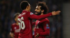 Mohamed Salah of Liverpool celebrates after scoring a goal to make it 0-2 with Trent Alexander-Arnold of Liverpool during the UEFA Champions League Quarter Final second leg match between Porto and Liverpool (Photo by Matthew Ashton - AMA/Getty Images)