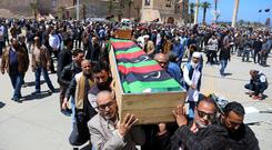 Victims: People carry coffins of those who were killed in overnight shelling, at Martyrs' Square in Tripoli, Libya. Photo: Reuters