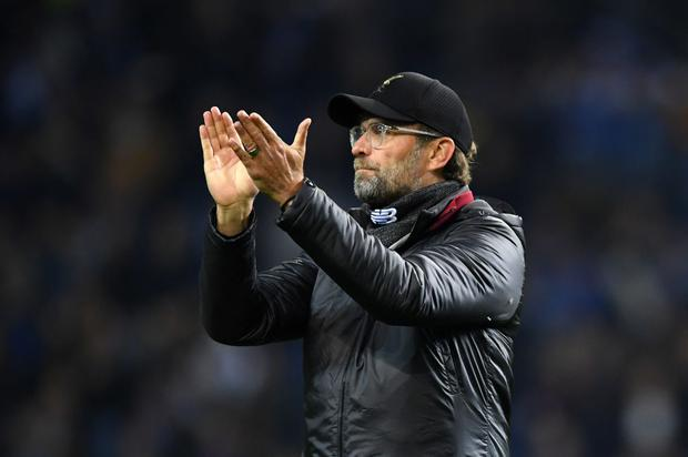 Jurgen Klopp, Manager of Liverpool shows appreciation to the fans after the UEFA Champions League Quarter Final second leg match between Porto and Liverpool at Estadio do Dragao on April 17, 2019 in Porto, Portugal. (Photo by Matthias Hangst/Getty Images)