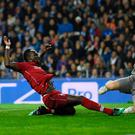 Main Mane: Sadio Mane stretches to put Liverpool in front in their victory against Porto last night. Photo: Matthias Hangst/Getty Images