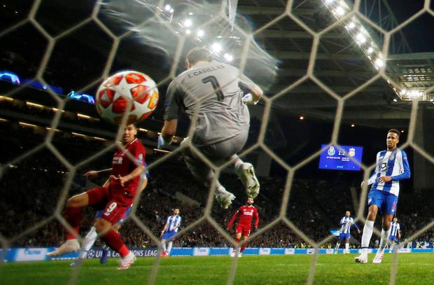 Iker Casillas can do little to stop Roberto Firmino scoring Liverpool's third goal. Photo: Action Images via Reuters/Andrew Boyers